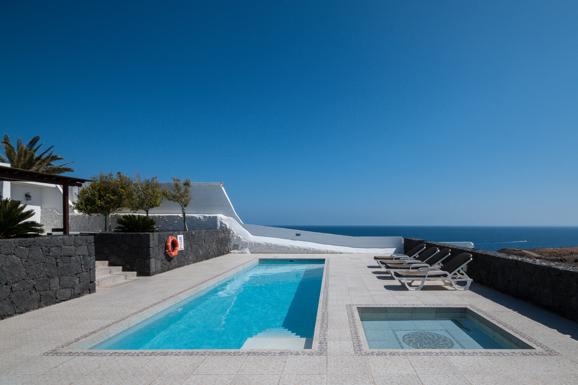 Lanzarote builders villa and apartment referbishments for Pool design villa