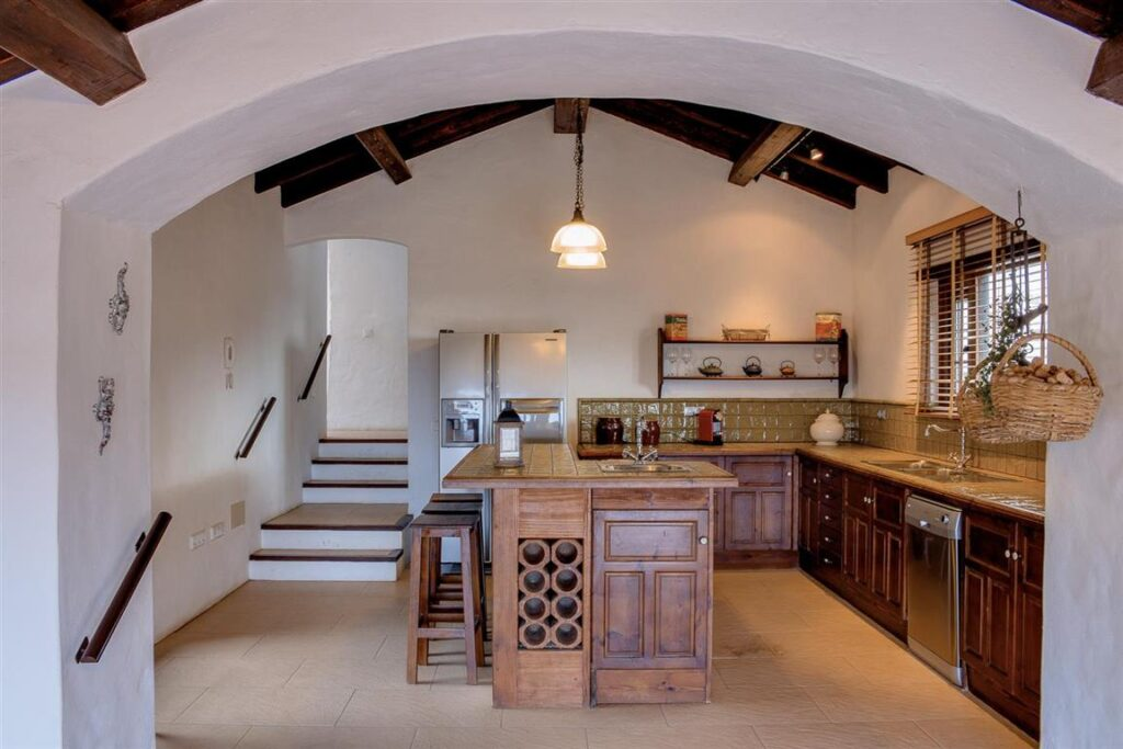 Open plan kitchen with traditional kitchen doors